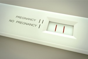Pregnancy test in action.Two lines in result window means pregnant.